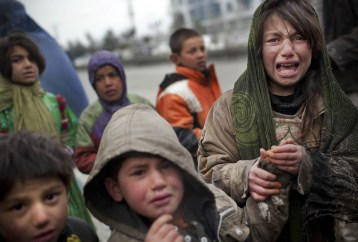 An Afghan refugee girl reacts after another child stole her food voucher while she was queuing in front a truck organized by the World Food Program in Kabul, on March 4, 2012. (AP Photo/Anja Niedringhaus) #