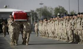 Comrades of fallen Canadian trooper Larry Rudd carry his casket onto a plane during a ramp ceremony at Kandahar Airfield, on May 26, 2010. Rudd, 26, was the 146th member of the Canadian military to die in Afghanistan since the U.S.-led invasion in 2001. (AP Photo/Anja Niedringhaus) #
