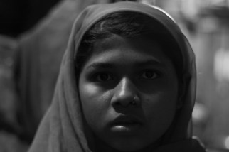 Mizan (13): She studies in 4th grade and aspires to be a Doctor. Her father works in the nearby water park and is involved in drugs,hence doesnt contribute much to the household expenditure. she narrated me a story how a 13 year old girl was killed by a young boy inside the camp itself,after her family refused to get her married to the boy. after instances like these, she is very scared and hardly talks to people around and doesn't even move out of her small room in the camp except going to school.