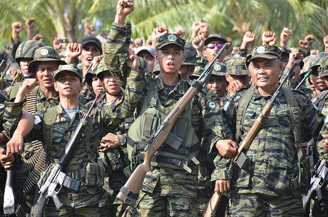 MILF combatants celebrate of the signing of the Peace Agreement. Photo: Meg Kagawa