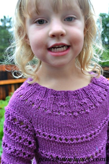 knitting a purple dress