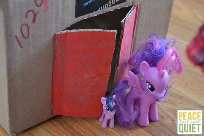 Do you have a ton of cardboard shipping boxes leftover from Christmas? Try making these easy pony stables -- as much fun to make as they are to play with!