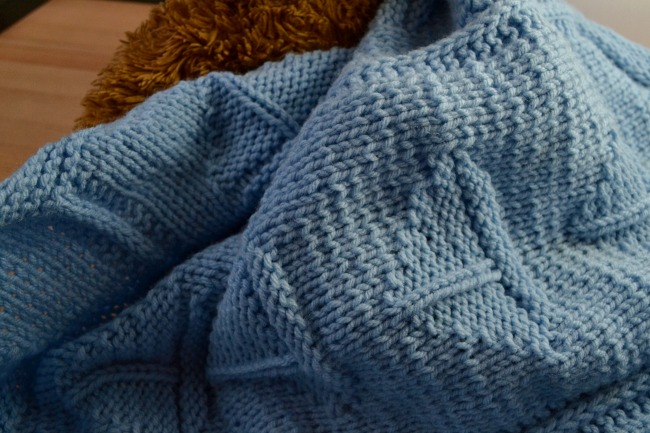The Sailboat Blanket is an easy knitting pattern -- great for beginners!