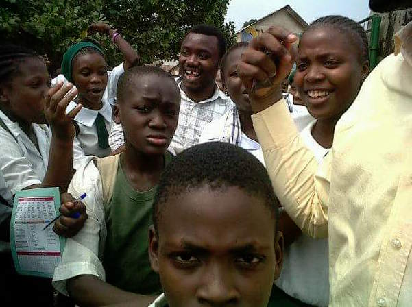 Abayomi Rotimi Mighty with School Children Photo Credit Facebook