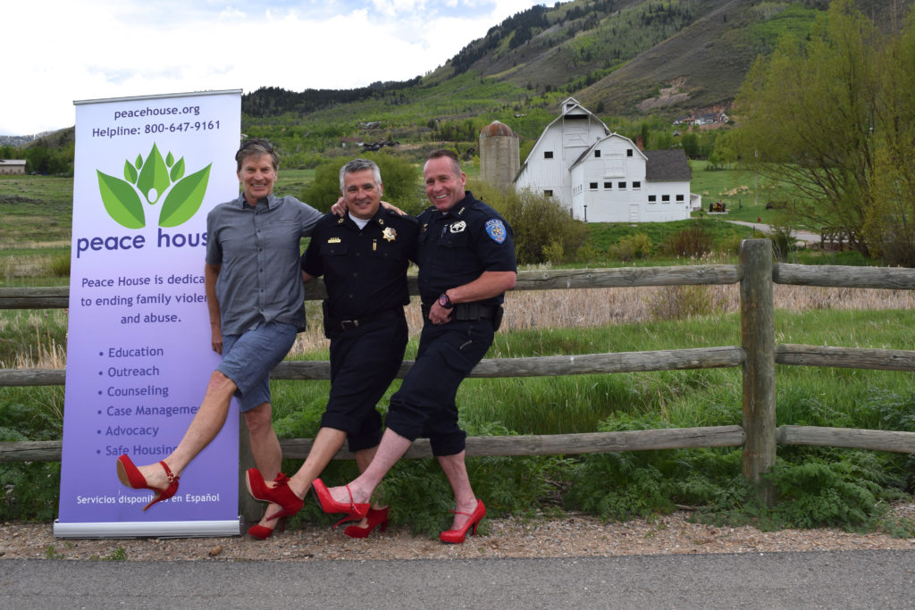 park city police in red heels for walk a mile in her shoes
