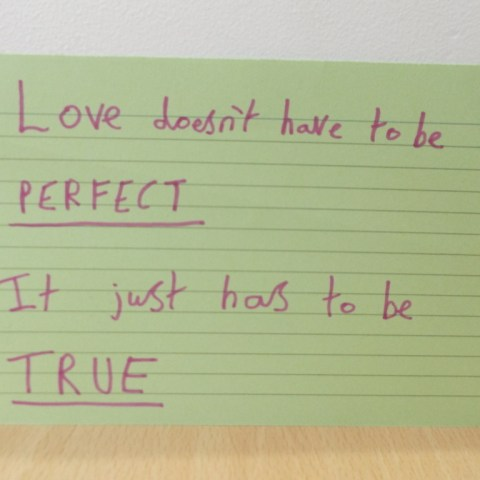 A card reading 'Love doesn't have to be perfect, it just has to be true.'