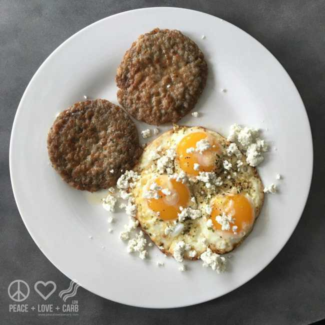 Pastured Eggs topped with Herbed Goat Cheese and Served with Sausage Patties | Peace Love and Low Crab