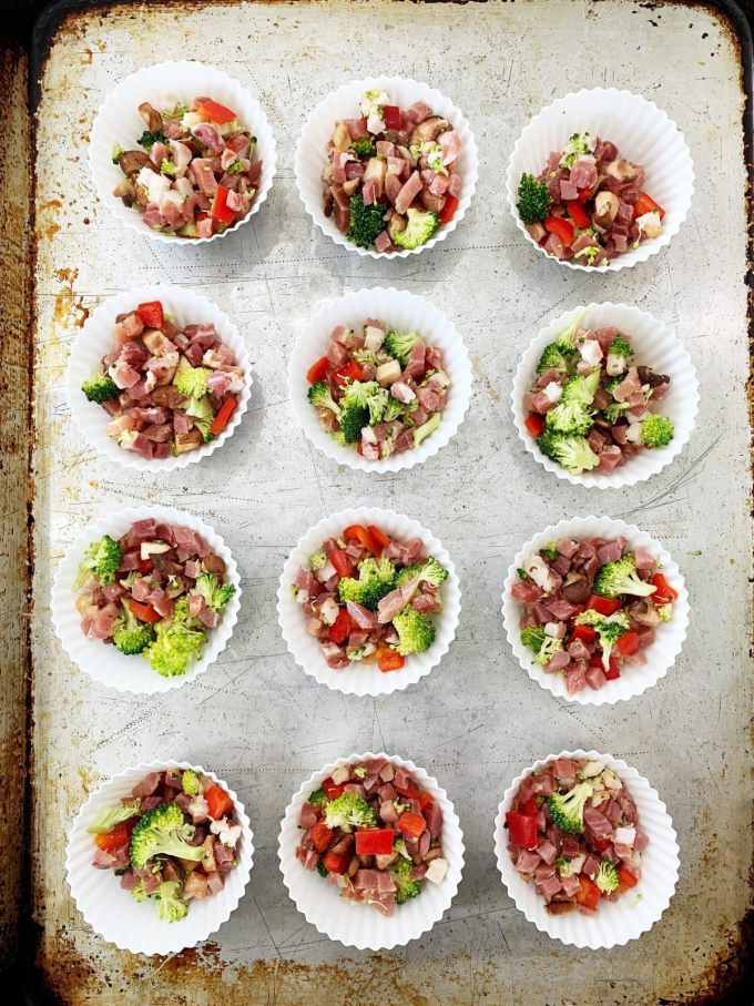 Overhead shot of muffin cups filled with meat and vegetables