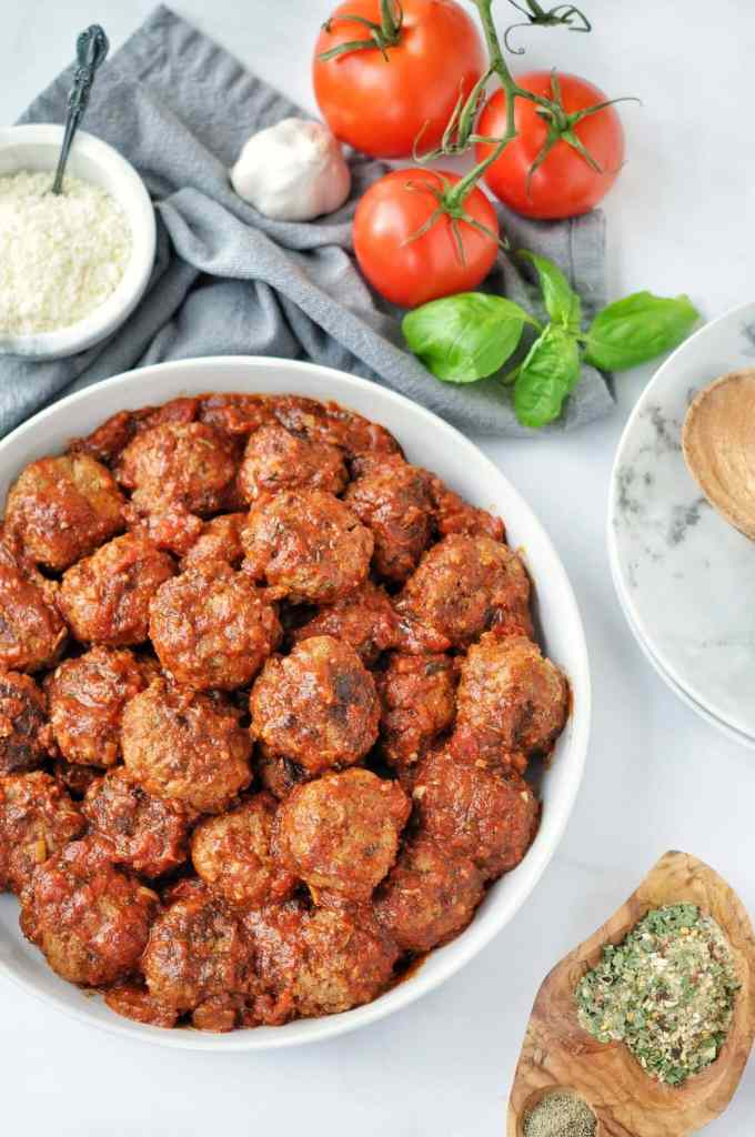 Overhead shot of slow cooked meatballs in tomato sauce