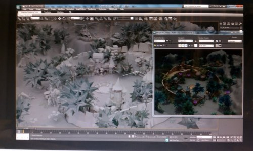 Game on the computer screen, lots of shrubbery.