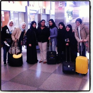 Group of Qatari students with their baggage.