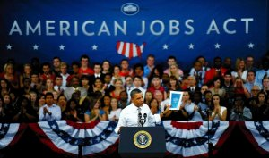 President Obama speaking in front of NC State students.
