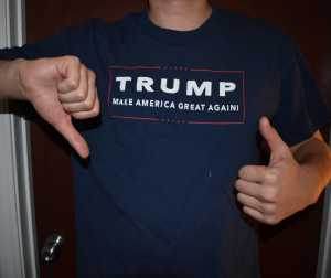 Person with Trump shirt, thumbs up and thumbs down