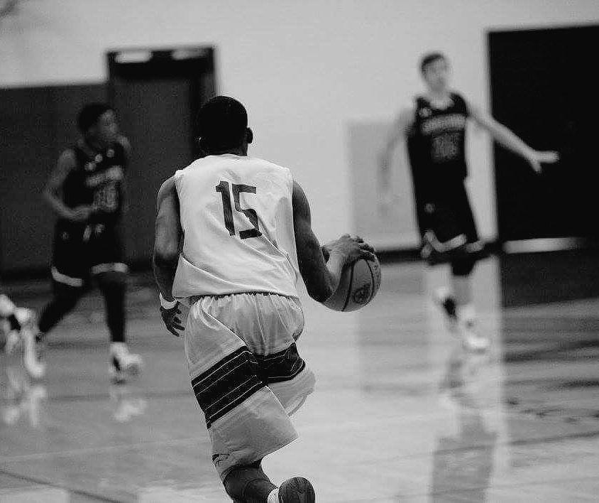 Jaylan Vance playing basketball at WPU