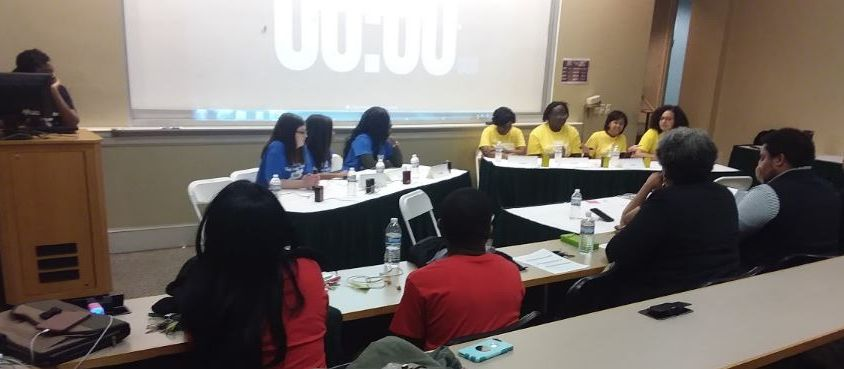 two tables with teams of students who are competing