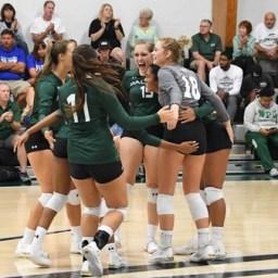 WPU Volleyball celebratory huddle