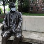 The statue of Mr. William Peace on main lawn is wearing a mask during the COVID-19 pandemic