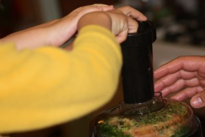 Many hands help in the juicing process