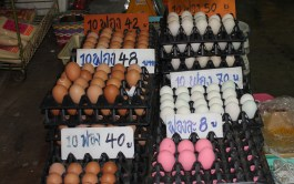 These eggs are put into mud for 100 days, taken out and cooked, cleaned and painted pink so as not to be confused with fresh eggs. They are black inside and apparently go well with beer