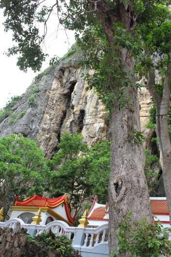 The outside looks just like an ordinary mountain but inside the cave is taken up in every corner by statues and worshipping areas
