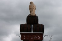 The eagle guarding the three tuns - barrels with precious ales inside.