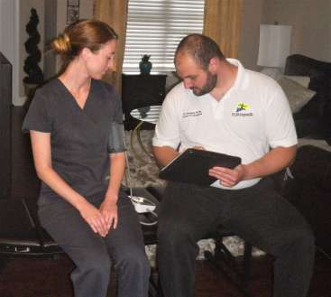 Dr. D- THE Mobile Chiropractor of DFW performing an exam.