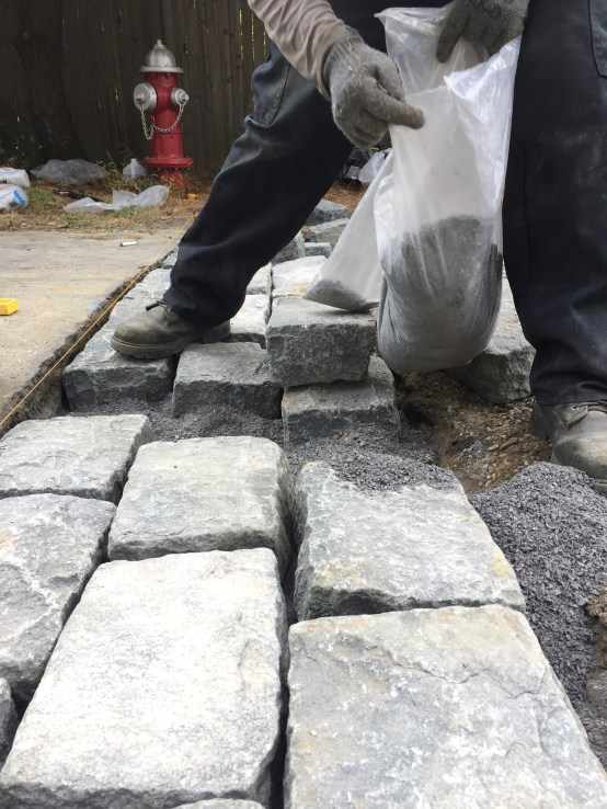 Additional stone dust added so that the blocks are flush with road