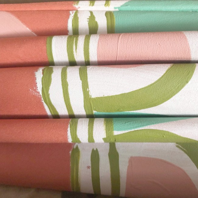 detail of a pastel colored custom garden umbrella by pearl and maude