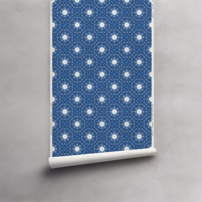 Roll of indigo blue and white wallpaper on grasscloth. Design - Beaufort by Pearl and Maude