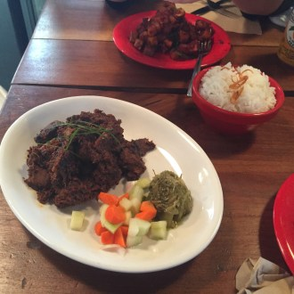 "The Rendang is cooked with ""too many spices to list"" and instead of a muddy somewhat familiar mix of spices on beef you taste something completely new and different."
