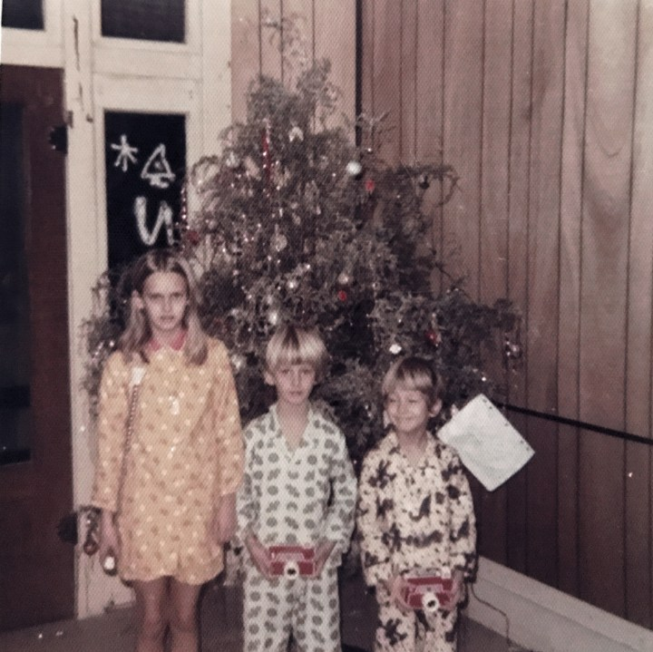 seventies kids in front of Christmas tree
