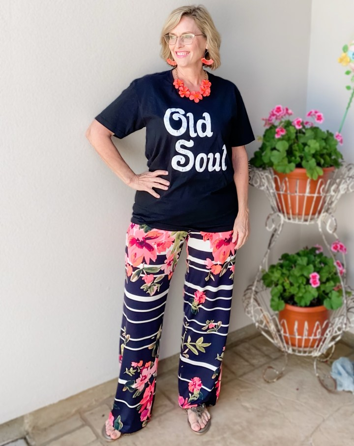 black graphic tee styled with floral wide leg pant