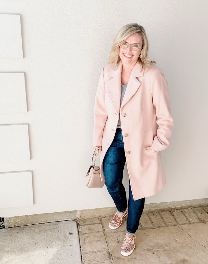 How to style a pink coat with jeans