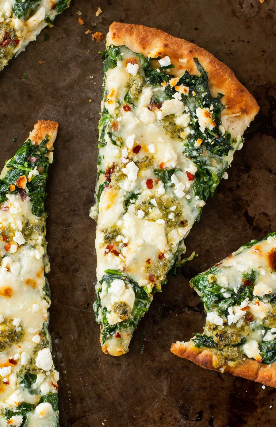 Three Cheese Pesto Spinach Flatbread Pizza. Alternate title: how to eat an entire 5oz box of spinach for lunch with out making a frickin' salad.