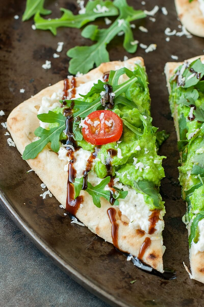 Toasted to perfection, this garlicky flatbread is topped with a lemony ricotta, a delicious whipped pea puree, and a hearty handful of fresh arugula. Finish it off with a drizzle of sweet balsamic glaze and you have a tasty party-perfect appetizer or light lunch!