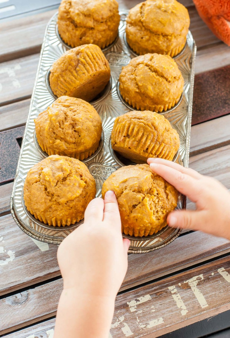 We love making these kid-friendly pumpkin muffins. They're super simple, gloriously healthy, and sweetened naturally with maple syrup!