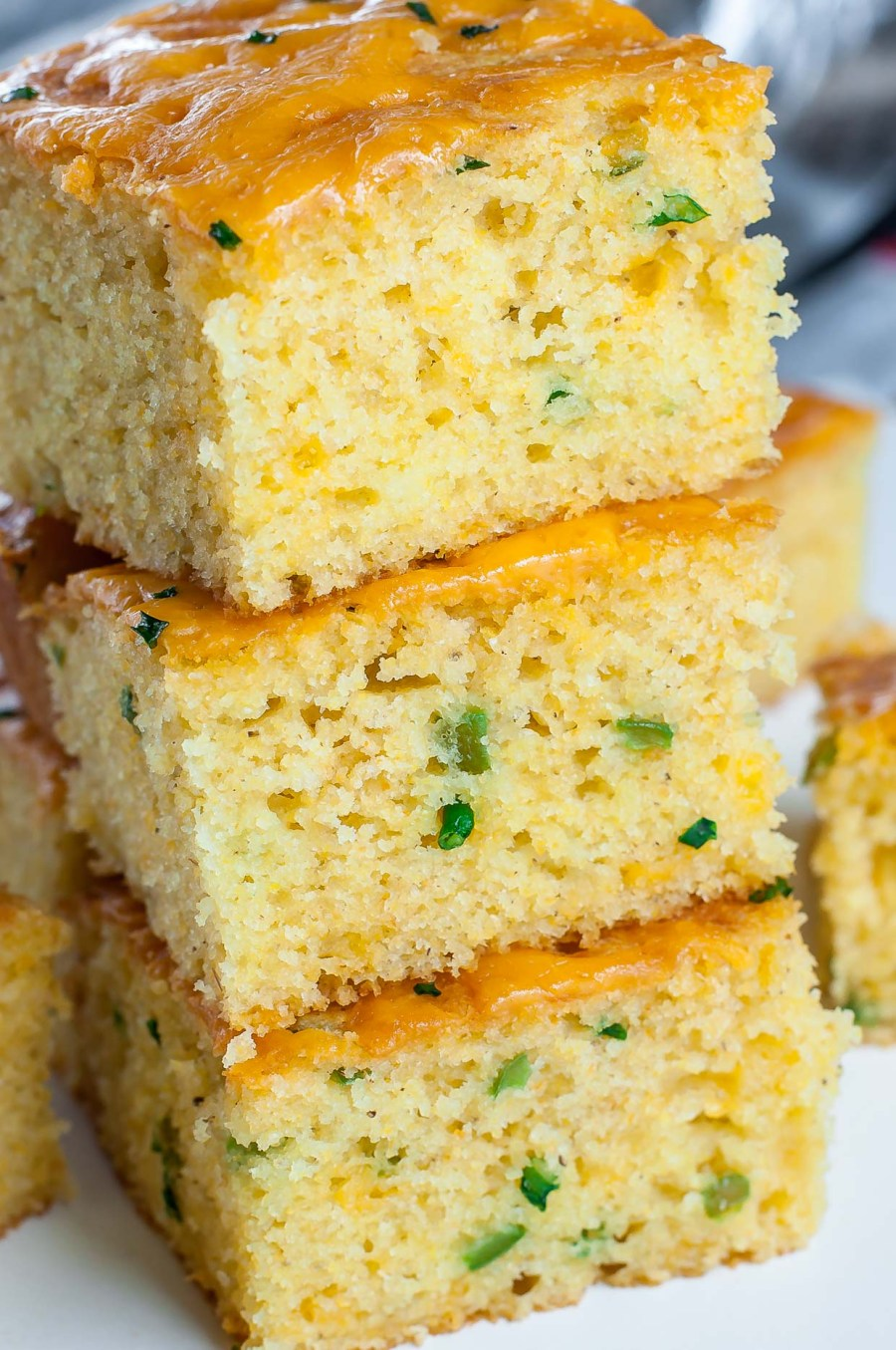 We love this Fuffy Jalapeño Cheddar Cornbread! This crazy good cornbread gets a leg up from two classic mix-ins: ooey gooey cheddar cheese and fiery jalapeño. The result is a kiss of heat blanketed by cheesy cornbread goodness.