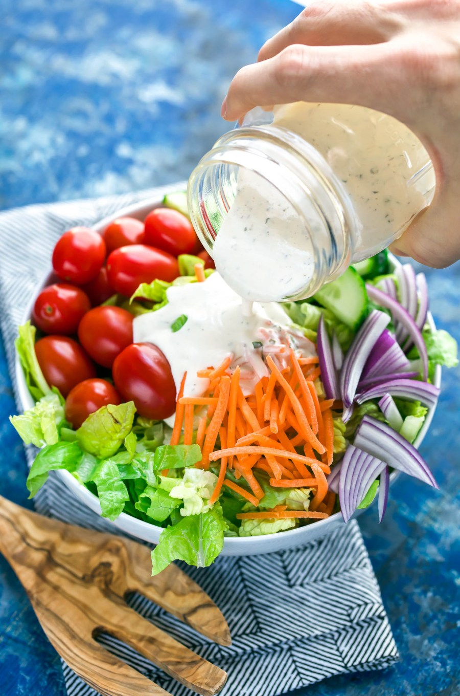 Ditch the sketchy processed bottled dressing and whip up this super quick, super easy, homemade paleo ranch dressing! Whole30 Compliant + Gluten-Free