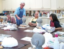 Students pay close attention to sculpting instructions by Ross Hart.