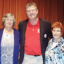 Ron Sites, president/executive director of the Luke AFB Fighter Country Partnership (FCP), poses with Judy Shaffer, left, president of the PC Singles Club and member Elizabeth Stelton who nominated the FCP for consideration as one of the club's 2015 charities. Mr. Sites awarded the two ladies a special Luke AFB medallion to recognize support for local military families.