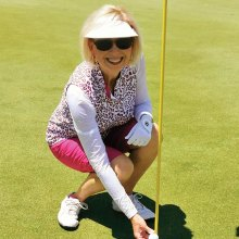 Debbie Sayre with her hole-in-one ball