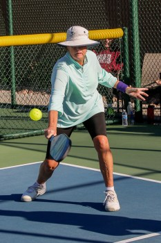 Sheri Sears keeps her eyes on the ball, practicing what she preaches; Photo by Dannie Cortez.