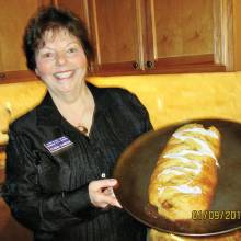Claudia Clarkson, President of Chapter P, showing what a beautiful pastry a Butter Braid is.