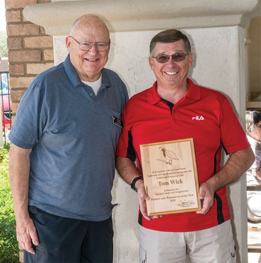 Gerald Findley presented the Carver of the Year award to Tom Wick.