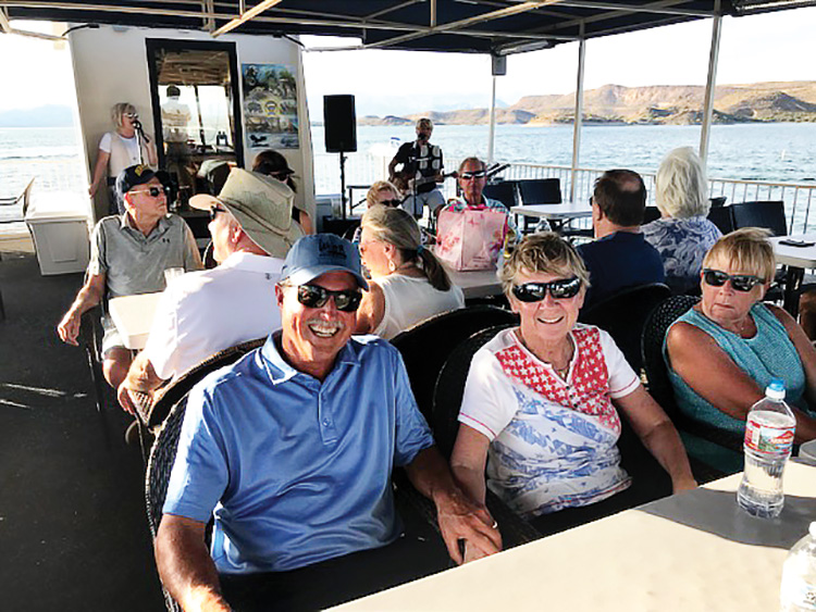 Rick and Sandy Haendel from unit 62B enjoy an evening on Lake Pleasant with their neighbors.