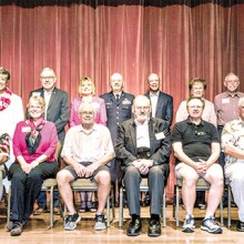 Twenty PebbleCreek veterans were honored with special, hand-made red, white, and blue quilts stitched by the PebbleCreek Quilters Club; Photo by Sandy Horvath.