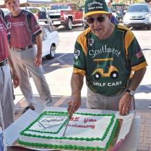 Bob Quarantino, one of the original players, is shown cutting the twenty-fifth-year anniversary cake.