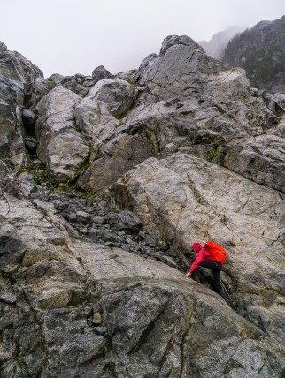 Scrambling up wet slabs above Niobe Meadows