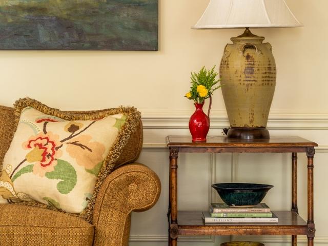 Beretania Circle Residence 7 family room green floral pillow ceramic jar lamp barn painting Pebbles Nix Interiors