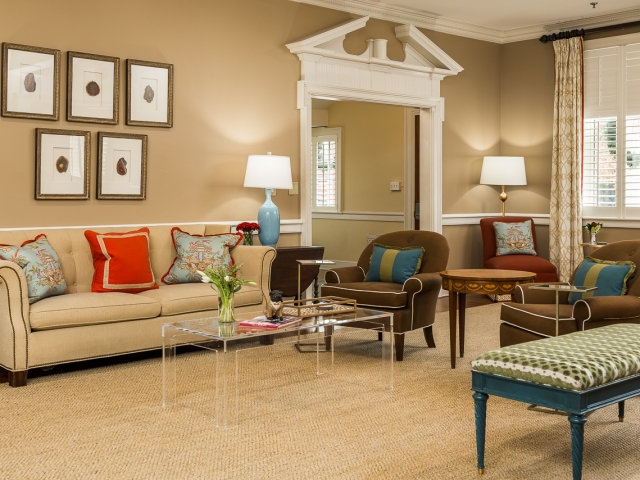 Pi Beta Phi Sorority House 5 living room tan brown red teal clear coffee table Pebbles Nix Interiors